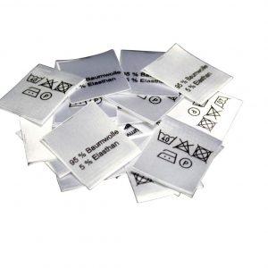 25 Textiletiketten 95% Baumwolle 5% Elasthan 25x30mm mittelgefaltet